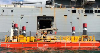 Sl1 Alongside Navy Vessel